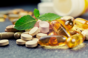 pills and multivitamins on a dark background closeup